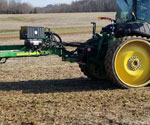 ProTakker 400DX with 8000 series John Deere tractor and 1770 planter in the field